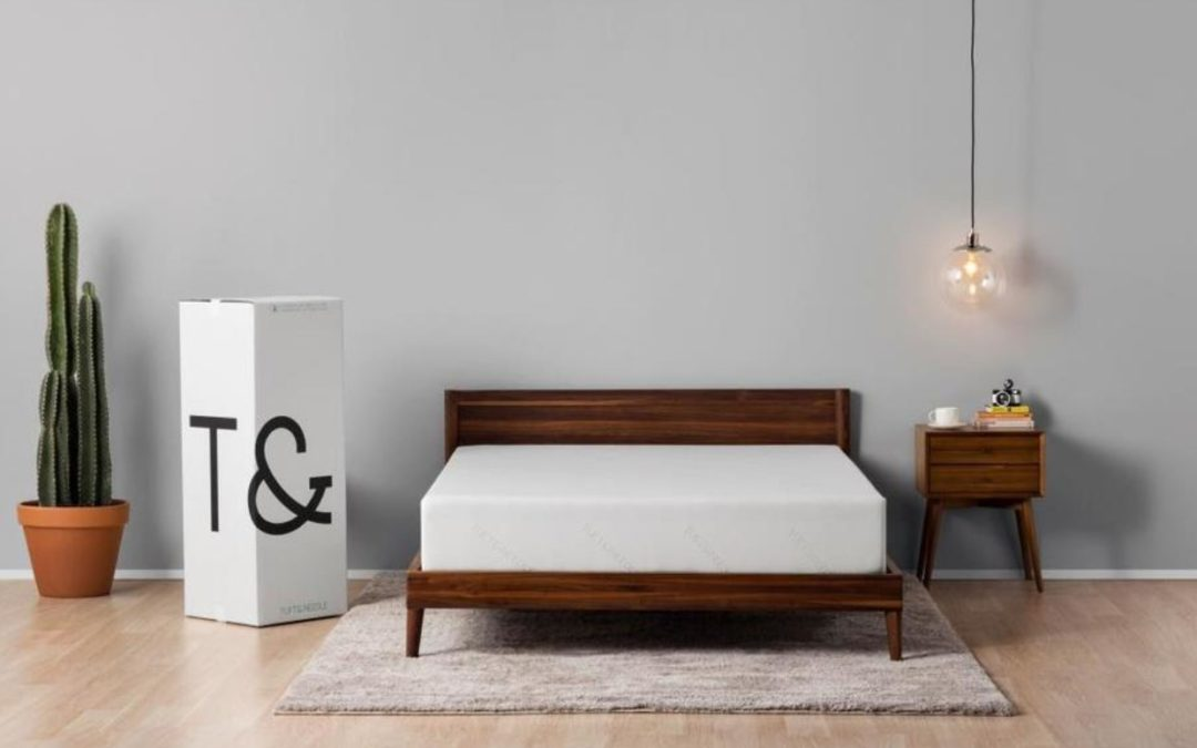 bed with mattress in bedroom